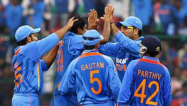 Indian team celebrates after picking up a wicket