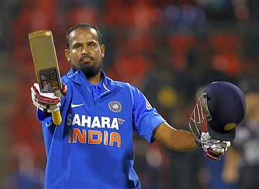 Yusuf Pathan celebrates after his century in Bangalore