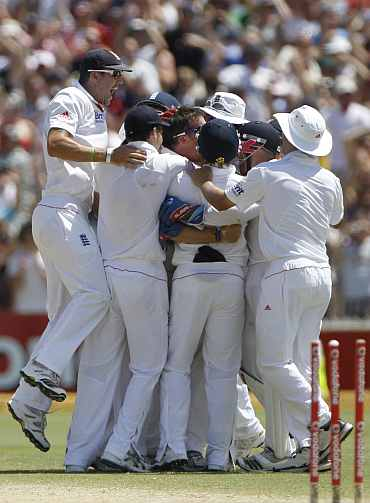 England players celebrate after winning the second Ashes Test in Adelaide