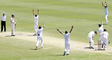 Graeme Swann reacts after picking the last wicket during the second Ashes Test in Adelaide
