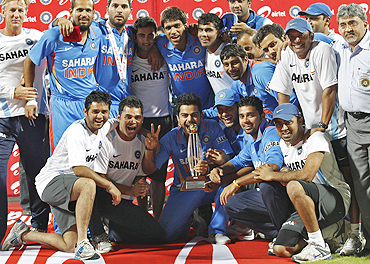 Members of Indian cricket team pose with the trophy after winning the series against New Zealand in Chennai on Friday