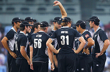 New Zealand players celebrate the dismissal of India's captain Gautam Gambhir in Chennai on Friday