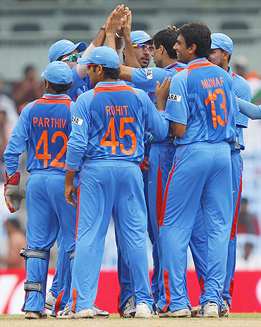 Indian players celebrate after the dismissal of New Zealand's Brendon McCullum in Chennai on Friday
