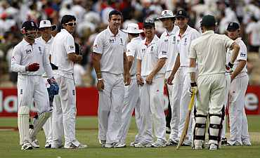 England players react to the dismissal of Australia's Michael Clarke