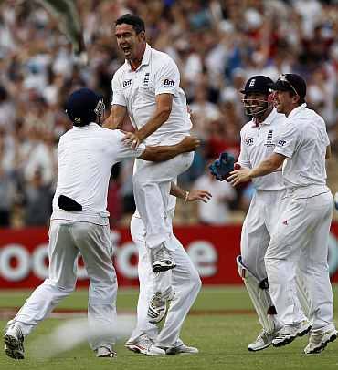 Kevin Pietersen celebrates after pickig up a wicket