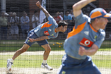 Mitchell Johnson bowls in the nets during a training session
