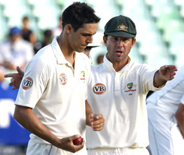 Mitchell Johnson with Ricky Ponting