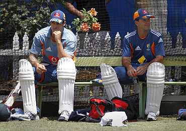 Mitchell Johnson sits next to Ricky Ponting after batting practice in the nets in Perth ahead of the third Ashes Test