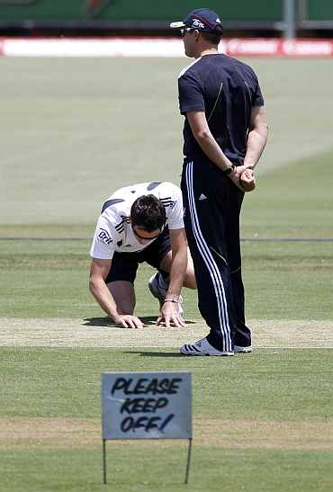 England's James Anderson checks the pitch ahead of the third Ashes Test in Perth