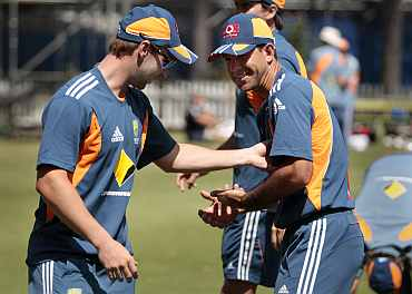 Australia's Phillip Hughes and Ricky Ponting joke around during a practice session ahead of the third Ashes Test in Perth
