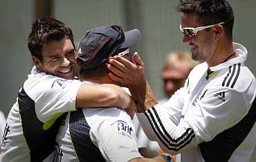 England's James Anderson and Kevin Pietersen joke around during a practice session ahead of the third Ashes Test in Perth