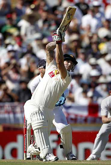 Australia's Mitchell Johnsonn hits a six during the third Ashes Test against England in Perth