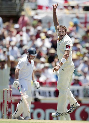 Australia's Ryan Harris appeals successfully for the wicket of England's Andrew Strauss (left)