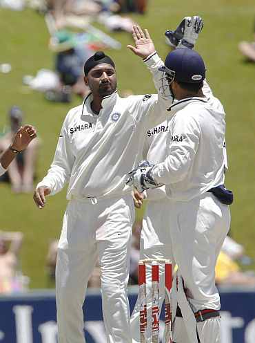 India's Harbhajan Singh celebrates after picking up South Africa's Graeme Smith during the first Test at Centurion