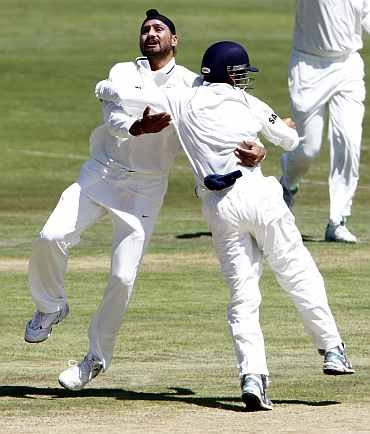 India's Harbhajan Singh celebrates after picking up South Africa's Alviro Petersen