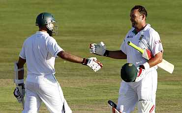 South Africa's Jacques Kallis celebrates with Hashim Alma after completing his century