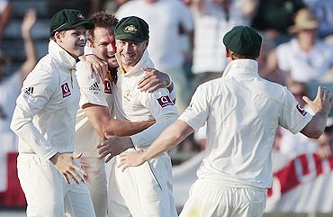 Australia's Ryan Harris (2nd from left) celebrates with teammates after dismissing England's Paul Collingwood