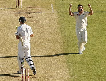 Australia's Ben Hilfenhaus (right) celebrates after claiming the wicket of England's Kevin Pietersen (left)