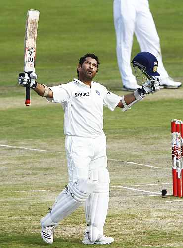 India's Sachin Tendulkar celebrates scoring his century against South Africa on the fourth day of the first Test in Pretoria