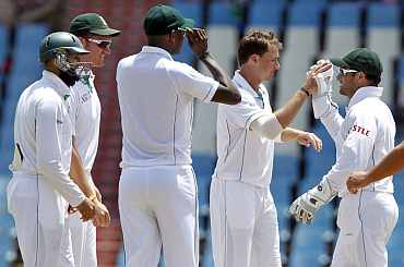 South Africa's Dale Steyn celebrates with team-mates after picking up India's Ishant Sharma duing the first Test in Centurion