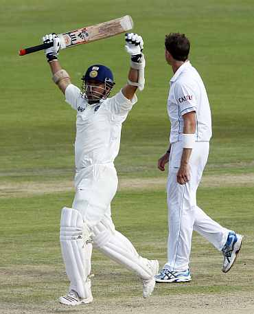 Sachin Tendulkar celebrates after completing his 50th Test century