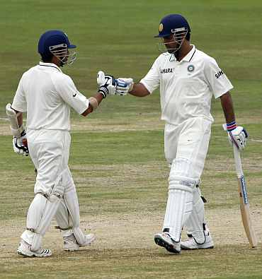 India's MS Dhoni and Sachin Tendulkar reacts during the fourth day of their first Test match against South Africa in Pretoria