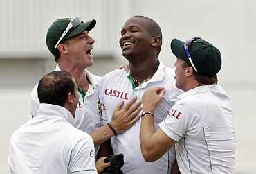 Lonwabo Tsotsobe celebrates after dismissing India's Sachin Tendulkar during the second Test match in Durban