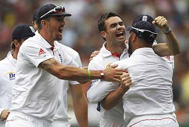 England's James Anderson celebrates after picking up a wicket during the fourth Ashes Test against Australia in Melbourne