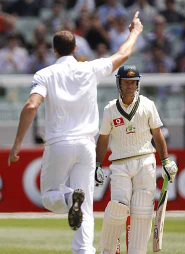 England's Chris Tremlett celebrates after picking up Ricky Ponting during the fourth Ashes Test against Australia in Melbourne