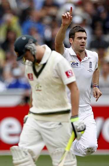 England's James Anderson celebrates after picking up Steven Smith during the fourth Ashes Test against Australia in Melbourne