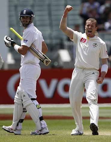 Australia's Peter Siddle celebrates after picking up England's Kevin Pietersen during the fourth Ashes Test against Australia in Melbourne