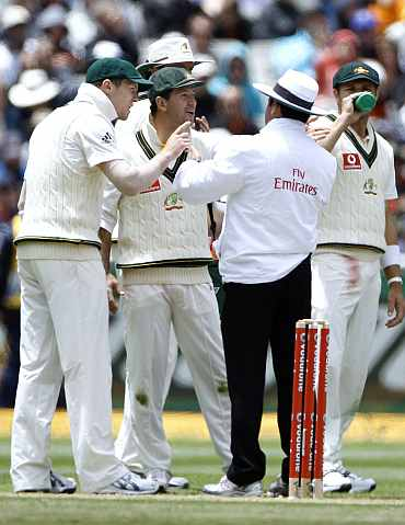 Australia's Ponting speaks to umpire Dar after an unsuccessful review during the second day of the fourth Ashes Test against England in Melbourne