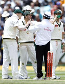 Australia's Ponting speaks to umpire Dar after an unsuccessful review