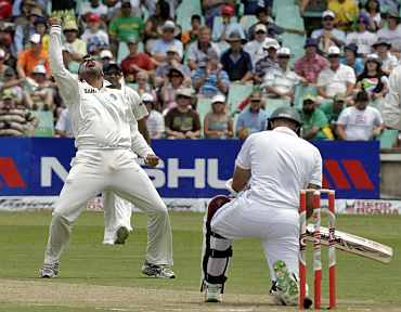India's Harbhajan Singh celebrates after picking up South Africa's Hasim Amla during the second Test in Durban