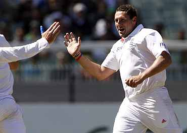 England's Tim Bresnan celebrates after picking up an Australian wicket during the fourth Ashes Test in Melbourne
