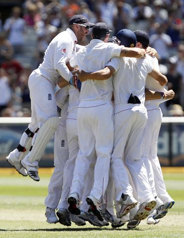 England's players celebrate after dismissing Ben Hilfenhaus, Australia's last wicket