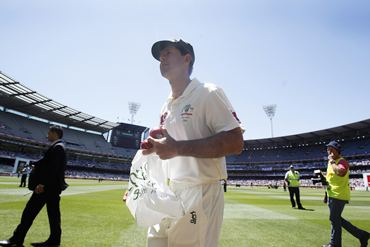 A dejected Ponting walks off the MCG after the humiliating defeat