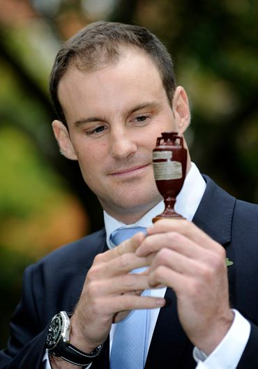 England's Strauss looks at a replica of the Ashes urn at Lord's before the team left for Australia