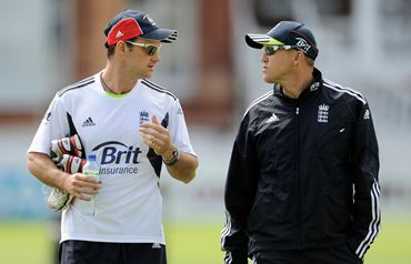 Strauss (L) chats with coach Andy Flower before a training session at Lord's