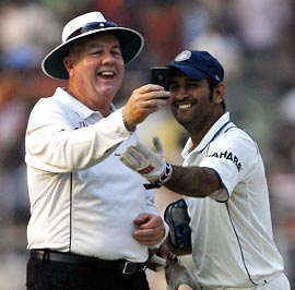 Umpire Steve Davis (left) with Mahendra Singh Dhoni