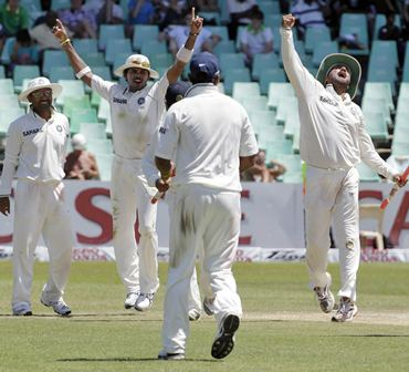 India's players celebrate the fall of a South Africa wicket in Durban