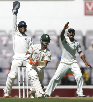 Dhoni (left) and Murali Vijay successfully appeal against South Africa's Jean-Paul Dumini