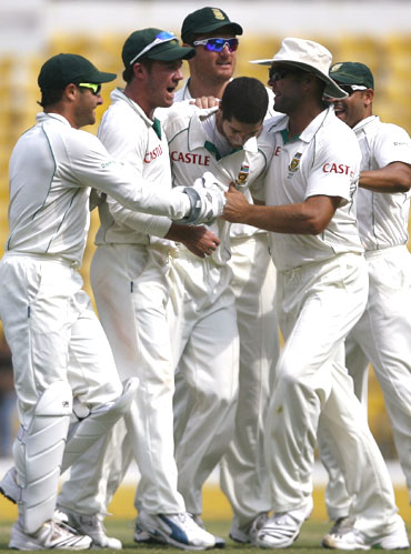 South Africa's Wayne Parnell (centre) is congratulated by team-mates after dismissing India's S Badrinath