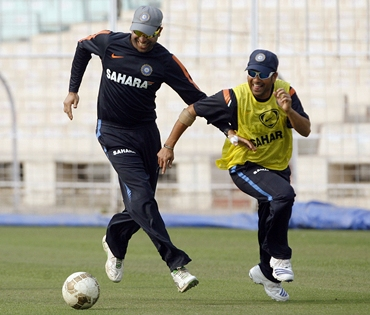 Sachin Tendulkar and VVS Laxman chase a football during practice