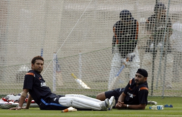 Tendulkar and Harbhajan Singh take a break in the nets
