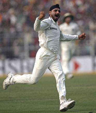 Harbhajan Singh rejoices after claiming the wicket of JP Duminy