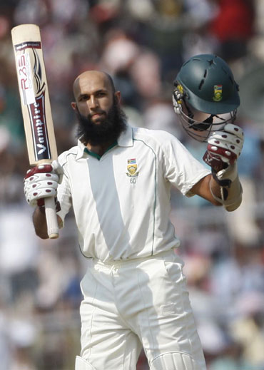 Hashim Amla reacts after he celebrates his century