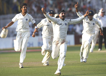 Harbhajan Singh celebrates after taking Morkel's wicket