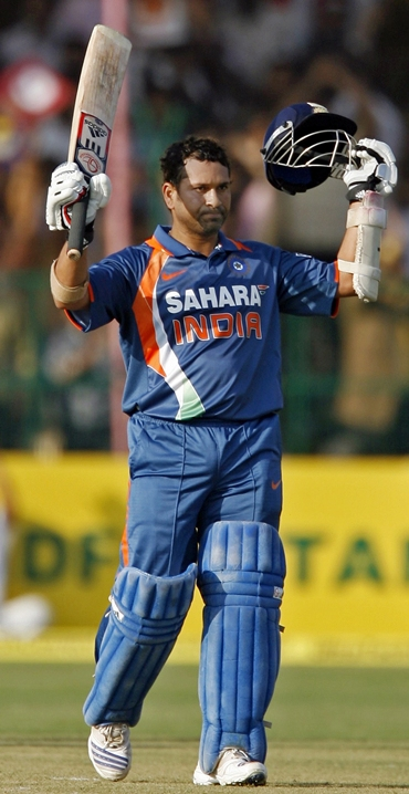 Tendulkar celebrates after scoring 100