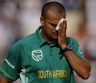 Langeveldt holds a cloth to the injury he suffered while trying to stop a shot from India's Tendulkar